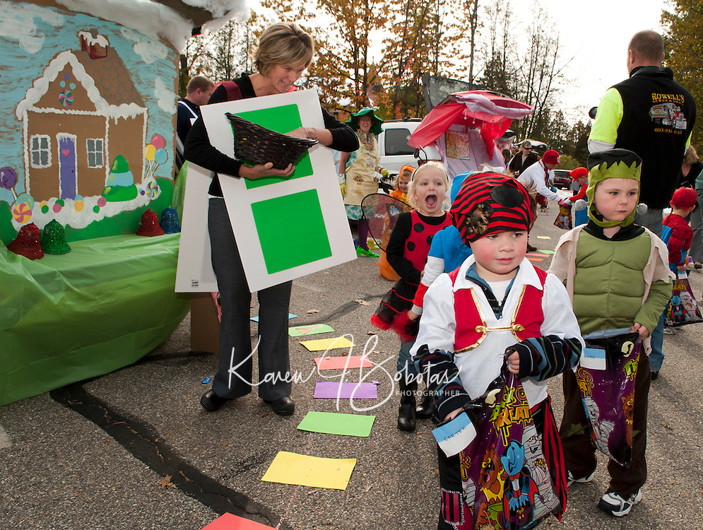 """Carter Jones wanders through """"Candy Land"""" decorated by Ms. Mint (Mandie Hagan) Gramma Nut (Debbie Rowell),  Chris Harris and Jodie Gallant as playing cards during Holy Trinity School's """"Trunk or Treat"""" Monday afternoon.  (Karen Bobotas/for the Laconia Daily Sun)"""