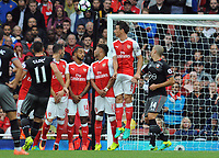 Football - 2016 / 2017 Premier League - Arsenal vs Southampton <br /> <br /> Dusan Tadic of Southampton chips the ball over the Arsenal wall to score his goal at the Emirates Stadium.<br /> <br /> <br /> Credit : Colorsport / Andrew Cowie