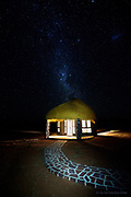 The Milky Way gradually comes into view in a crystal clear sky over our hut at the We Kabi Safari Lodge (Maltahöhe) in central Nambia. The heat was intense even at night and although the thatched roof looked fantastic, the lack of fan and air conditioning made sleep almost impossible.<br /><br />Outside however the air was cool enough to enjoy just staring at the incredible night sky. This was the darkest sky I've ever seen and it depicted the stars and constellations with a clarity that I've never before experienced.