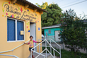 Giovana outside the front of the community library, Biblioteca Comunitaria do Arquipelago, Porte Alegre, Brazil. <br /> <br /> Prior to its complition this library was a run down shed and it's now full of books and has lots of colourful cushions on the floor . There is art and craft hanging from the walls and the celing.<br /> <br /> Cirandar is working in partnership with  C&A and C&A Instituto to implement a network of Community Libraries in eight communities of Porto Alegre.