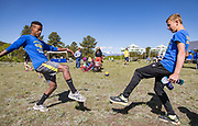 Members of the Custer County High School Crosscountry Team play hacky sack before Hardscrabble Mountain Trail Run at Bear Basin Ranch, to benefit the San Isabel Land Protection Trust.