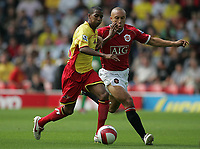Photo: Lee Earle.<br /> Watford v Manchester United. The Barclays Premiership. 26/08/2006. Watford's Ashley Young (L) battles with Mikael Silvestre.