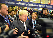 © Licensed to London News Pictures. 08/10/2012. Birmingham, UK Boris Johnson Lord Mayor of London arrive at Birmingham News Street Station by train ahead of his fringe meeting at The Conservative Party Conference at the ICC today 8th October 2012. Photo credit : Stephen Simpson/LNP
