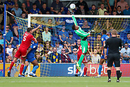 AFC Wimbledon goalkeeper Nathan Trott (1) making save during the EFL Sky Bet League 1 match between AFC Wimbledon and Accrington Stanley at the Cherry Red Records Stadium, Kingston, England on 17 August 2019.