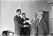 21/06/1963<br /> 06/21/1963<br /> 21 June 1963<br /> Presentation by Mr. Corcoran to Mr. Yeats in recognition of 25 years service at Esso at the Esso Petroleum offices.