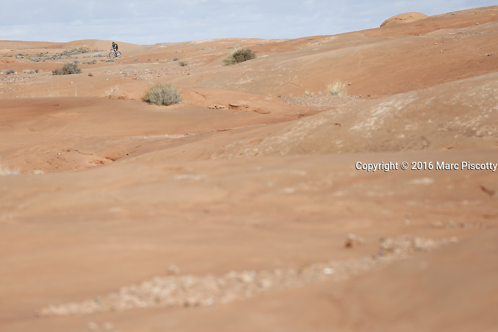SHOT 10/18/16 11:06:06 AM - Emery County Utah tourism photos including hiking and exploring Goblin Valley including an arch rappel, the Black Dragon Canyon and  mountain biking Saucer Basin with Lamar Guymon. (Photo by Marc Piscotty / © 2016)