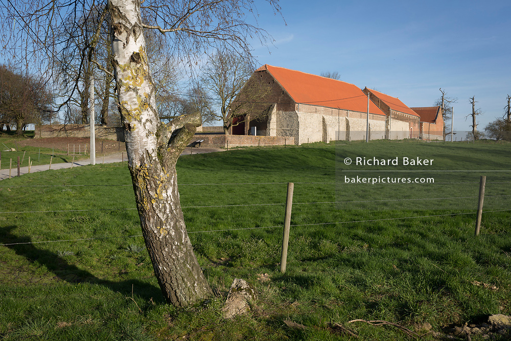 Exterior of the strategically-important Hougoumont Farm during the Battle of Waterloo, on 25th March 2017, at Waterloo, Belgium. <br /> The farm became an epicentre of fighting in the Battle as it was one of the first places where British and other allied forces faced Napoleon's Army. 12,000 allied troops defending 14,000 French. The Battle of Waterloo was fought on 18 June 1815. A French army under Napoleon Bonaparte was defeated by two of the armies of the Seventh Coalition: an Anglo-led Allied army under the command of the Duke of Wellington, and a Prussian army under the command of Gebhard Leberecht von Blücher, resulting in 41,000 casualties.