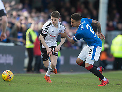 Rangers' James Tavernier (right) and Ayr United's Alan Forrest battle for the ball during the William Hill Scottish Cup, fifth round match at Somerset Park, Ayr.