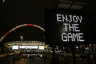 an electronic sign with the words 'Enjoy the game' is seen outside  Wembley Stadium before the game. England v Spain, Football international friendly at Wembley Stadium in London on Tuesday 15th November 2016.<br /> pic by John Patrick Fletcher, Andrew Orchard sports photography.