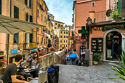 A vacationing couple enjoys as simple breakfast in the village of Riomaggiore, one of the five antique fishing villages of Cinque Terre Italy