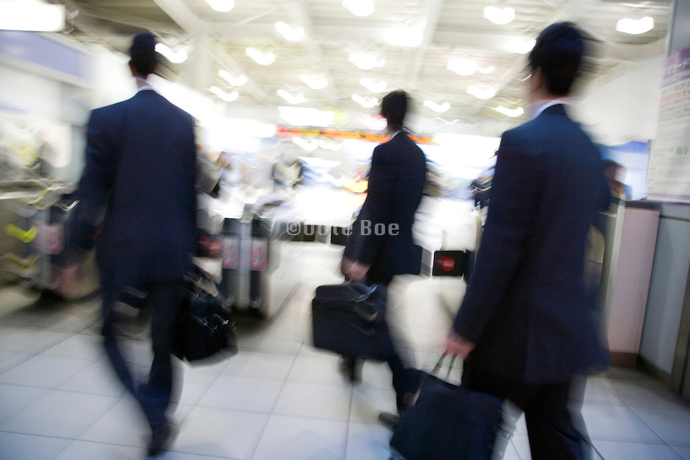 business commuters rushing towards a turnstile Japan Tokyo
