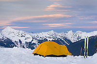 Winter backcountry campsite at dusk in the North Cascades, Washington
