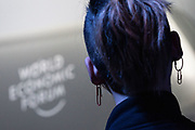 A young participant listens to the panel in the The Global Impact of Australia's Wildfires session at the World Economic Forum Annual Meeting 2020 in Davos-Klosters, Switzerland, 22 January. Congress Centre - Issue Briefing Room. Copyright by World Economic Forum/ Greg Beadle