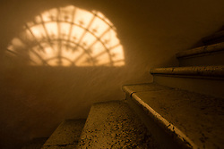 Stone Staircase and Sunlight Casting Shadow on Wall