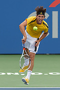 DOMINIC THIEM hits a serve during his match on day four at the Citi Open at the Rock Creek Park Tennis Center in Washington, D.C.