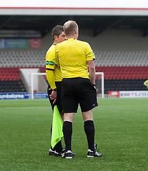Linesman tells ref Northcroft about an incident resulting in Falkirk's Lyle Taylor getting a second yellow card..Airdrie United 0 v 1 Falkirk, 30/3/2013..©Michael Schofield..