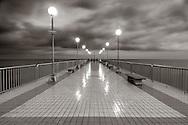 The pier of Pietra Ligure in Liguria, Italy. Taken at dusk under some heavy rain.
