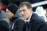 West Ham United manager Slaven Bilic looks on from the dugout.  The Emirates FA cup, 4th round replay match, West Ham Utd v Liverpool at the Boleyn Ground, Upton Park  in London on Tuesday 9th February 2016.<br /> pic by John Patrick Fletcher, Andrew Orchard sports photography.
