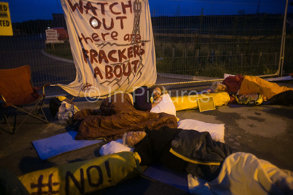 12 local activists locked themselves in specially made arm tubes to block the entrance to Quadrillas drill site in New Preston Road, July 03 2017, Lancashire, United Kingdom. Councillor Gina Dowding. The 13 activists included 3 councillors; Julie Brickles, Miranda Cox and Gina Dowding and Nick Danby, Martin Porter, Jeanette Porter,  Michelle Martin, Louise Robinson,<br /> Alana McCullough, Nick Sheldrick, Cath Robinson, Barbara Cookson, Dan Huxley-Blyth. The blockade is a repsonse to the emmidiate drilling for shale gas, fracking, by the fracking company Quadrilla. Lancashire voted against permitting fracking but was over ruled by the conservative central Government. All the activists have been active in the struggle against fracking for years but this is their first direct action of peacefull protesting. Fracking is a highly contested way of extracting gas, it is risky to extract and damaging to the environment and is banned in parts of Europe . Lancashire has in the past experienced earth quakes blamed on fracking.