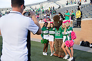 Marco the buffalo takes a photo with the Marshall cheerleaders before kickoff against the North Texas Mean Green at Apogee Stadium in Denton, Texas on October 8, 2016. (Cooper Neill for The Herald-Dispatch)