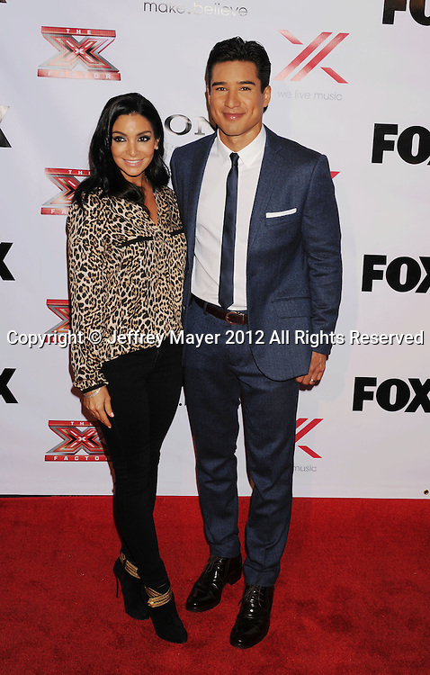 LOS ANGELES, CA - DECEMBER 06: Mario Lopez and Courtney Mazza arrive at the 'The X Factor' Viewing Party Sponsored By Sony X Headphones at Mixology101 & Planet Dailies on December 6, 2012 in Los Angeles, California.