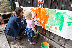 © Licensed to London News Pictures. 08/09/2015. London, UK. Labour party leadership candidate, LIZ KENDALL MP painting with children during her visit to Clapham Manor Children's Centre in south west London. Photo credit : Vickie Flores/LNP