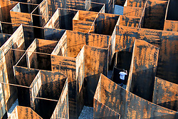 Sept. 26, 2016 - Genk, Belgium - A visitor walks in ''Labyrinth'', an experimental metal maze installation in Genk, Belgium. With the weight of 186 tons and walls of up to five metres in height, the maze was opened for public visit from July 2015 to September 2016.  (Xinhua/Zhang Yunlong) (zf) (Credit Image: © Zhang Yunlong/Xinhua via ZUMA Wire)