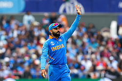Virat Kohli of India raises his hand - Mandatory by-line: Robbie Stephenson/JMP - 09/07/2019 - CRICKET - Old Trafford - Manchester, England - India v New Zealand - ICC Cricket World Cup 2019 - Semi Final