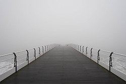 © Licensed to London News Pictures. 04/04/2014<br /> <br /> Saltburn by the Sea, United Kingdom<br /> <br /> Heavy fog shrouds the Victorian pier in Saltburn by the Sea in Cleveland.<br /> <br /> Photo credit : Ian Forsyth/LNP