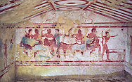 """Underground Etruscan tomb Known as """"Tomba Claudio Bettini no 5513"""" A single chamber with double sloping ceiling. In the tympanium on the back wall is a painted two lions, a two men lying on beds (Klinai) are  banquetting with two women bellow. On the dide walls are dancers and musicians. 5th century BC. Excavated 1967 , Etruscan Necropolis of Monterozzi, Monte del Calvario, Tarquinia, Italy. A UNESCO World Heritage Site. .<br /> <br /> Visit our ETRUSCAN PHOTO COLLECTIONS for more photos to buy as buy as wall art prints https://funkystock.photoshelter.com/gallery-collection/Pictures-Images-of-Etruscan-Historic-Sites-Art-Artefacts-Antiquities/C0000GgxRXWVMLyc"""