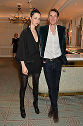 EDIE CAMPBELL and OTIS FERRY at the launch of Mrs Alice in Her Palace - a fashion retail website, held at Fortnum & Mason, Piccadilly, London on 27th March 2014.