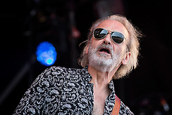 © Licensed to London News Pictures . 08/08/2015 . Siddington , UK . Wang Chung on stage at The Rewind Festival of 1980s music , fashion and culture at Capesthorne Hall in Macclesfield . Photo credit: Joel Goodman/LNP