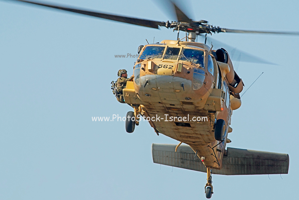 Israeli Air Force (IAF) Sikorsky UH-60 Blackhawk (Yanshuf) helicopter, in flight During a rescue mission