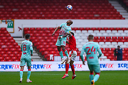 Andre Ayew of Swansea City climbs highest for a header - Mandatory by-line: Nick Browning/JMP - 29/11/2020 - FOOTBALL - The City Ground - Nottingham, England - Nottingham Forest v Swansea City - Sky Bet Championship