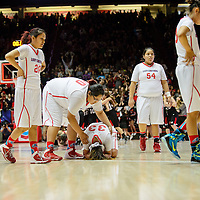 031414  Adron Gardner/Independent<br /> <br /> Shiprock Chieftain Shjantel Grey (00), center,  comforts Ashley John (33) as Aranxta Curley (20), left, Shontai Grey (54) and Tanisha Begay (23) walk off the court after losing the girls 3A basketball championship to the Portales Ram  59-62 at The Pit in Albuquerque Friday.