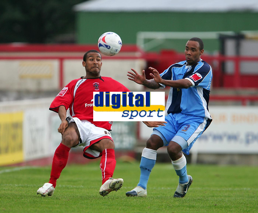 Photo: Andrew Unwin.<br />Accrington Stanley v Wycombe Wanderers. Coca Cola League 2. 30/09/2006.<br />Accrington Stanley's Romauld Boco (L) flicks the ball past Wycombe's Chris Palmer (R).