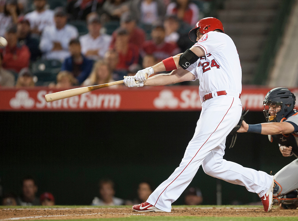 The Angels' C.J. Cron hits a walk-off home run in the ninth inning during the Angels' 11-9 victory over the Detroit Tigers Tuesday at Angel Stadium.<br /> <br /> ///ADDITIONAL INFO:   <br /> <br /> angels.0531.kjs  ---  Photo by KEVIN SULLIVAN / Orange County Register  -- 5/31/16<br /> <br /> The Los Angeles Angels take on the Detroit Tigers Tuesday at Angel Stadium.