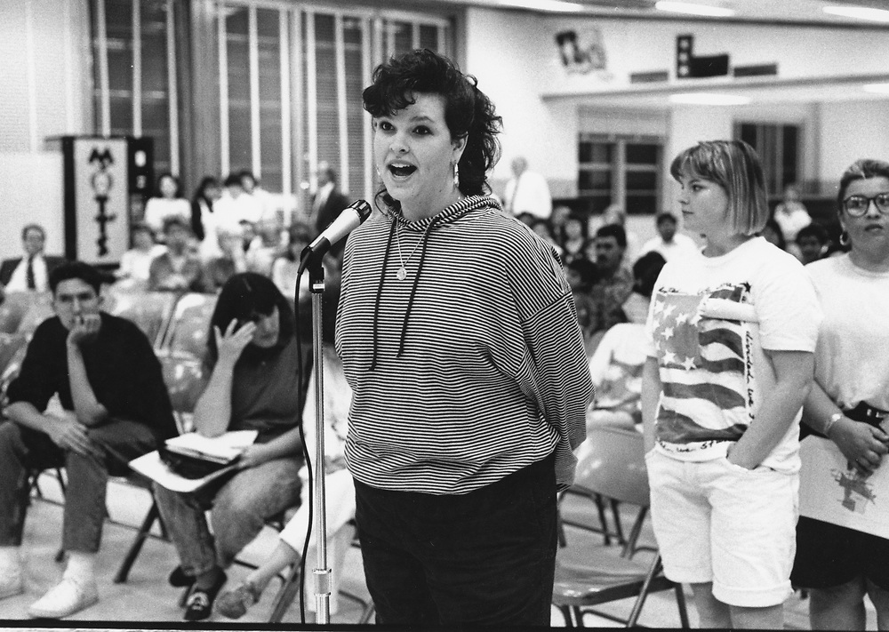 ©1991 Students speaking out at a public meeting about closing of their high school  Travis High School, Austin, Texas.