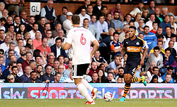 Jamaal Lascelles of Newcastle United runs with the ball at Kevin McDonald of Fulham - Mandatory by-line: Robbie Stephenson/JMP - 05/08/2016 - FOOTBALL - Craven Cottage - Fulham, England - Fulham v Newcastle United - Sky Bet Championship