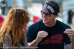 Announcer Jay Allan with a customer at the Broken Spoke Saloon during Daytona Beach Bike Week 2015. FL, USA. Tuesday March 10, 2015.  Photography ©2015 Michael Lichter.