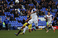 Tranmere Rovers' Stephen Arthurworrey and Notts County's Nathan Tyson (l)  chase the ball. Skybet football league one match, Tranmere Rovers v Notts county at Prenton Park in Birkenhead, England on Saturday 15th March 2014.pic by Chris Stading, Andrew Orchard sports photography.