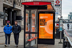 © Licensed to London News Pictures. 09/12/2020. LONDON, UK.  Covid-19 digital signage at a bus stop in the City of London.  London is currently in Tier 2 High Alert level, but it is reported that the city may move to Tier 3 Very High Alert level before Christmas as infections continue to rise across the capital.  Photo credit: Stephen Chung/LNP