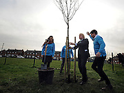 © Licensed to London News Pictures. 14/02/2012, Hillingdon, UK. BORIS JOHNSON helps to plant the tree with volunteers from RE:LEAF a partnership of businesses and organisations involved in the planting scheme. Mayor of London Boris Johnson marks the delivery of the the 10,000 tree promised to Londoners in his manifesto by planting a Acer Campestre, commonly known as a Field Maple, in Hillingdon today 14 February 2012.  Photo credit : Stephen Simpson/LNP
