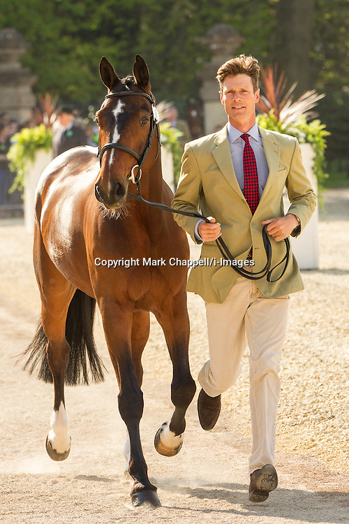 William Fox-Pitt (GBR) leads Parklane Hawk for the vet's inspection during the trot up at the 2013 Mitsubishi Motors Badminton Horse Trials. Thursday 02  May  2013.  Badminton, Gloucs, UK.<br /> Photo by: Mark Chappell/i-Images
