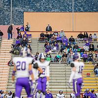 Gallup fans watch their Miyamura Patriots  on the field play against the St. Pius X Sartan at Wilson Stadium in Albuquerque Thursday.