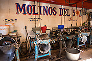 Grinding and mixing machines that create mole at Benito Juarez market in Oaxaca, Mexico.