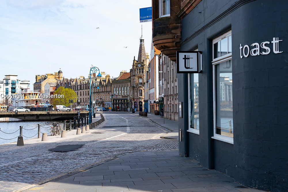 View of The Shore in Leith during the coronavirus lockdown with all shops and restaurants closed and nobody on the street, Scotland, UK
