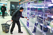Customers are seen shopping for items meanwhile groceries, meat, as well as hygienic shelves, go empty very fast at most supermarkets in London, Monday, March 16, 2020. For most people, the new coronavirus causes only mild or moderate symptoms, such as fever and cough. For some, especially older adults and people with existing health problems, it can cause more severe illness, including pneumonia. (Photo/Vudi Xhymshiti)