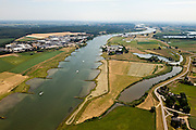 Nederland, Gelderland, gemeente Buren, 08-07-2010; Neder-Rijn, De Tollewaard met steenfabriek. In het kader van het Programma Ruimte voor de Rivier zijn er plannen om de uiterwaard te vergraven: door de uiterwaard komt een nevengeul, rechts van de huidige fabrieksterreinen en aansluitend op de bestaande rivierstrengen..Under the Program 'Room for the River', there are plans to construct a flood trench, right of the factory sites connected to the existing river strands..luchtfoto (toeslag), aerial photo (additional fee required).foto/photo Siebe Swart.