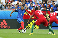 Portugal Midfielder Joao Moutinho takes on Portugal Midfielder William Carvalho and Portugal Defender Cedric Soares during the Euro 2016 final between Portugal and France at Stade de France, Saint-Denis, Paris, France on 10 July 2016. Photo by Phil Duncan.